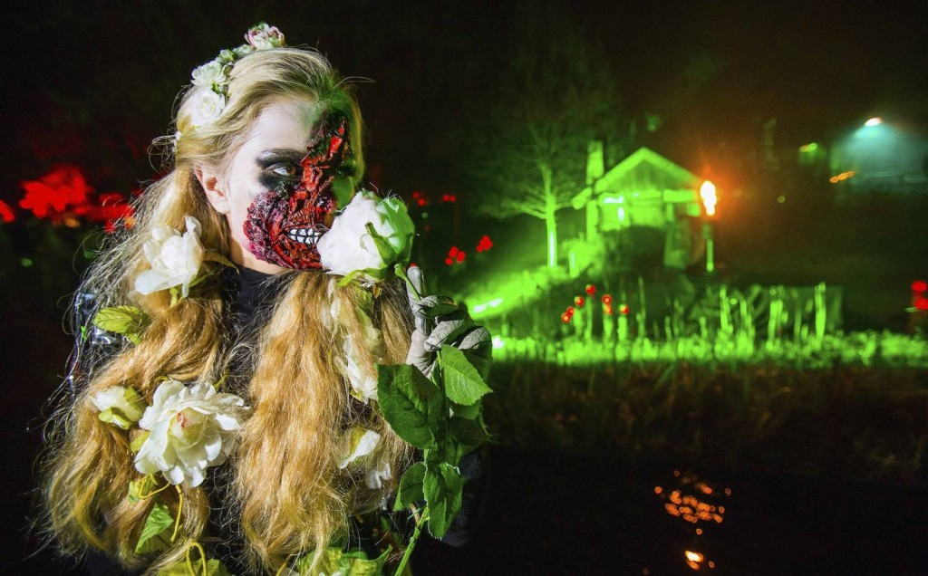 """A woman attends the """"Horror Nights"""" at the Filmpark Babelsberg theme park during Halloween in Potsdam"""